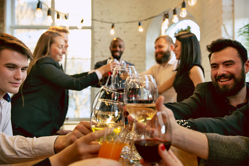 image of employees toasting at a holiday party